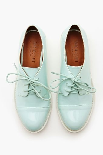 Charlie Oxford - Mint    The coolest mint vegan leather oxfords featuring a lace-up front and white contrast sole. Fully lined interior, cushioned insole. Looks perfect paired with everything from crop skinnies to a skater skirt! By Nasty Gal.