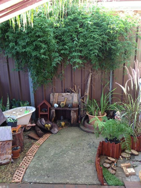 This outdoor environment has several invitation areas for children to explore, from a wheelbarrow sand pit, to animals scattered all over. Great way to engage children's imagination. - Puzzles Family Day Care  Environment.  For more inspiring spaces: http://pinterest.com/kinderooacademy/provocations-inspiring-classrooms/ ≈ ≈