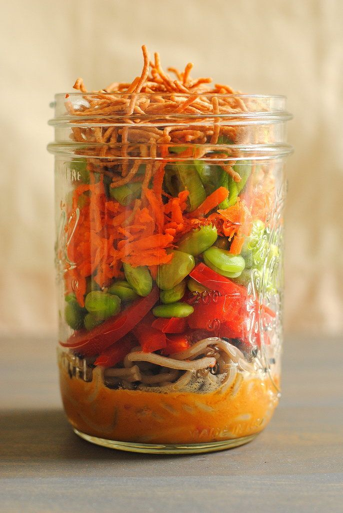 Spicy Peanut Soba Noodle Salad with Edamame and Carrots More Asian Noodle Salads, Salad Jars, Jars Salad, Soba Noodles, Asian Noodles Salad, Mason Jars, Rice Noodles, Peanut Dresses, Peanut Butter Asian Noodle Salad Jars - Cook soba noodles. Meanwhile, whisk peanut butter, sambal oelek, rice vinegar and soy sauce, then slowly incorporate oil. Stir in sesame seeds and divide sauce between 4 pint-sized mason jars. Divide noodles over dressing. Layer red pepper, edamame, carrots, green onions…