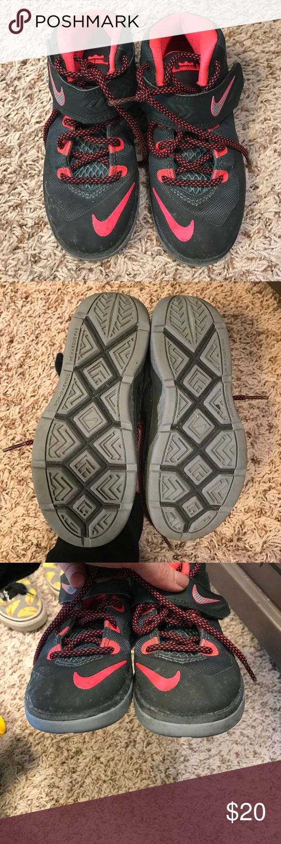 Boys Nike shoes Pink and dark green boys Nikes in good condition used but still have a lot of life. No holes and soles are good. A little wipe an they are like new Nike Shoes Sneakers