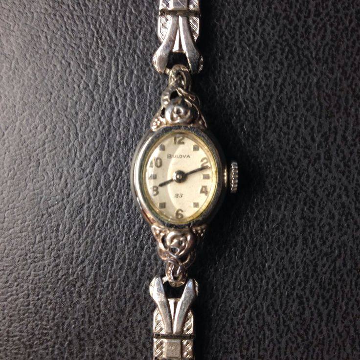 Vintage Bulova #23 Women's rose watch with silver band  by PastFunk on Etsy