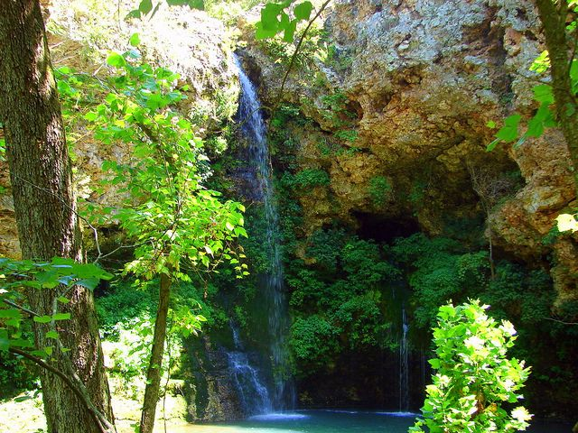 """This is Natural Falls State Park in far eastern Oklahoma. It's the largest waterfall in Oklahoma and scenes from """"Where the Red Fern Grows"""" were shot here. I took my kids to see it last summer and was overwhelmed by the beauty and the power of the waterfall.  Oklahoma Waterfall 