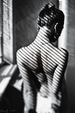 love the playing with light and shadow in photos. it adds an intimacy to the photo and a classic, old timey feel (or maybe thats because of the black and white)