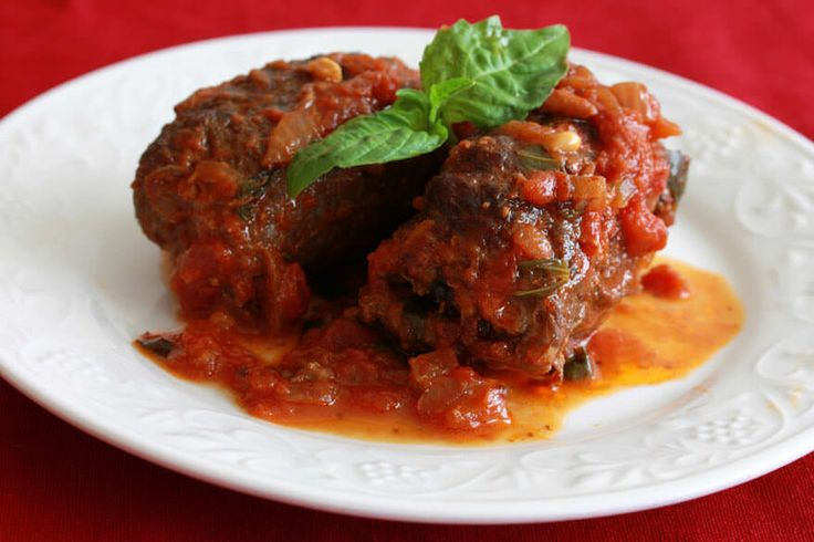 Braciole, or involtini, di Manza, is a traditional, authentic Italian dish. These beef rolls are filled with a delicious medley of flavor combinations.