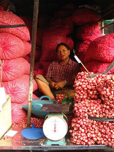 man selling garlic, Bangkok, Thailand