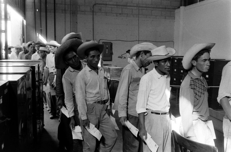 Mexican migrant farm workers at reception center in Hidalgo, Texas, line up for job interviews, 1959