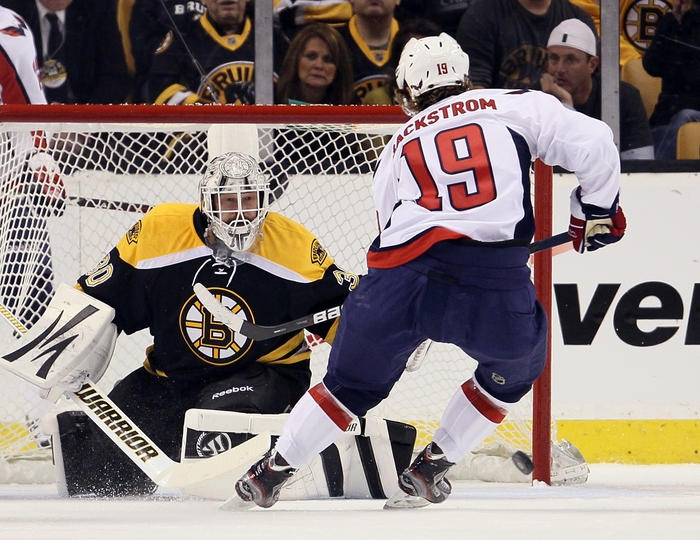 BOSTON, MA - APRIL 12: Tim Thomas #30 of the Boston Bruins stops a shot by Nicklas Backstrom #19 of the Washington Capitals in Game One of the Eastern Conference Quarterfinals during the 2012 NHL Stanley Cup Playoffs at TD Garden on April 12, 2012 in Boston, Massachusetts. (Photo by Elsa/Getty Images)