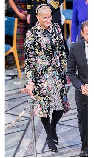 Meanwhile, Crown Princess Mette-Marit of Norway wore a colorful floral coat and striped dress as she joined her husband Crown Prince Haakon for the Nobel Peace Prize ceremony at Oslo City Town Hall. The future queen accessorized with peach gloves, patent leather heels and a sweet hairband.   Photo: © Nigel Waldron/Getty Images