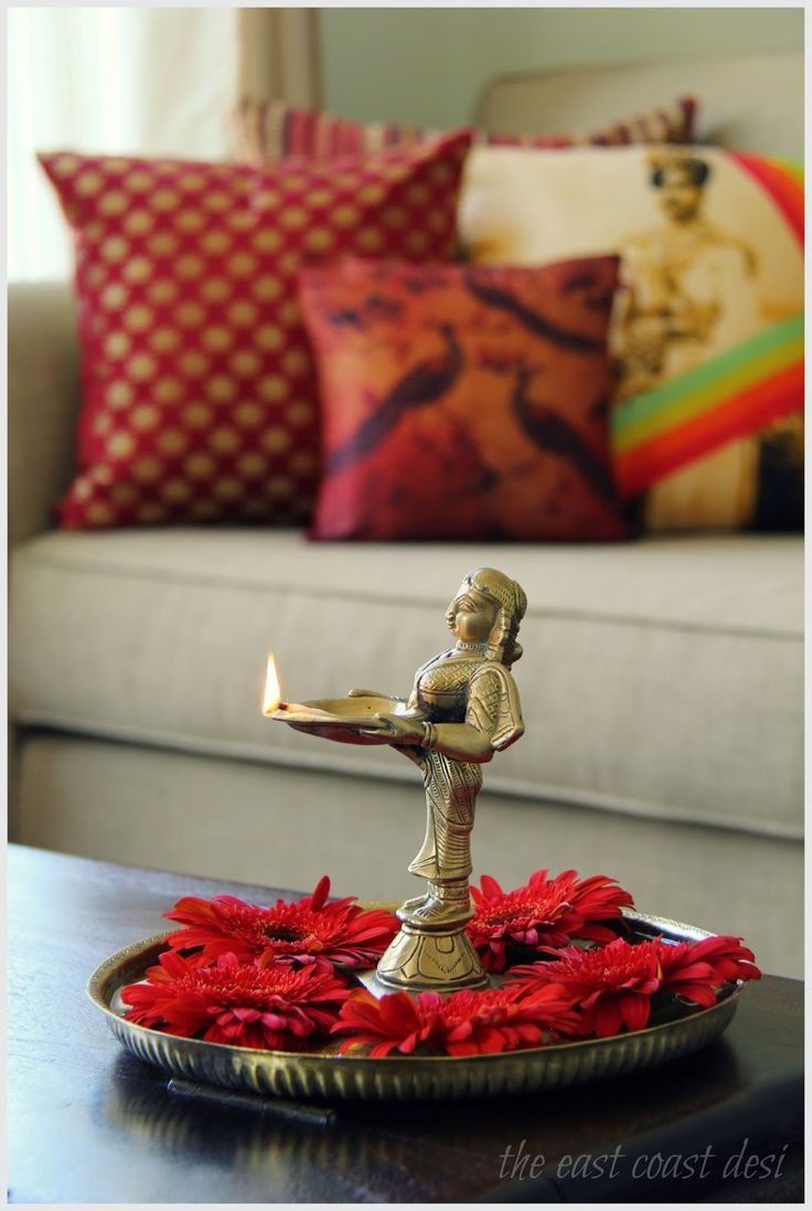 Brass thali with a bunch of flaming red Gerberas. Red and gold combinations