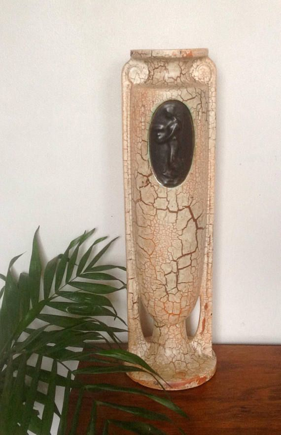 A tall, Art Deco, Urn shaped floor vase in stoneware with crackle glaze, made by Ditmar Urbach in the 1930s as part of the Czech Alien Ware collection. This unusual and elegant floor vase depicts a female figure carrying an Urn , in relief , in a black panel on each side....it has a