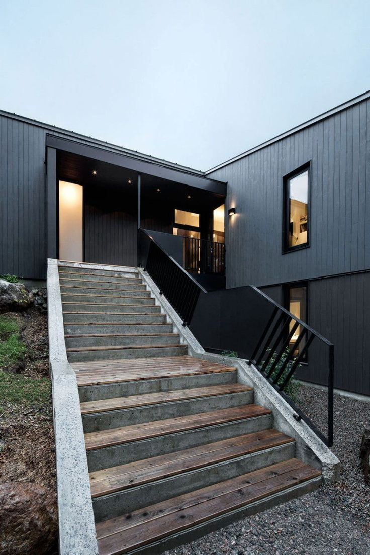 Great-Home-Exterior-Using-Black-Metal-Outdoor-Metal-Stairs-with-Undone-Staircase-Cement-Staircase-Design-For-Modern-Home-Design