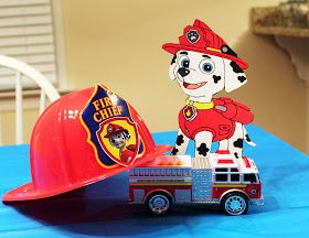 """On a lighter note...: a Paw Patrol """"paw-ty"""" each table with different dog, his hat and vehicle"""