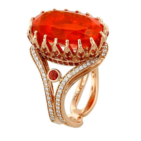 18k rose gold ring featuring 7.29 carat fire opal, accented with 0.97 carat orange sapphires and 0.42 carat brilliant cut diamonds.