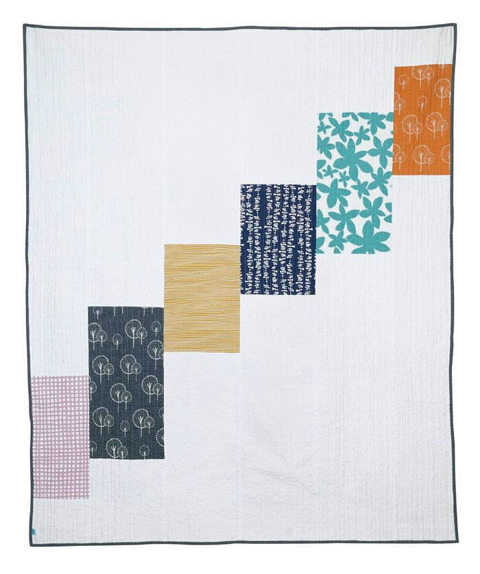 Back of a quilt, waterfall design, with pieces of Lotta Jansdotter fabrics at Film in the Fridge.