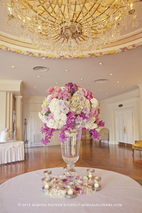 Large floral arrangement in atrium at queen s landing