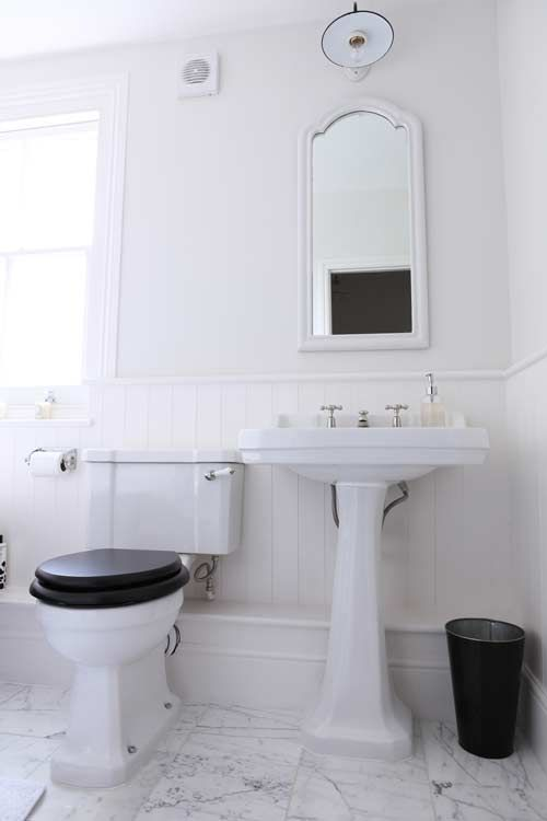 Traditional fixtures, i.e. pedestal sink, traditional  taps, etc. And the black toilet seat really classes up the W.C.