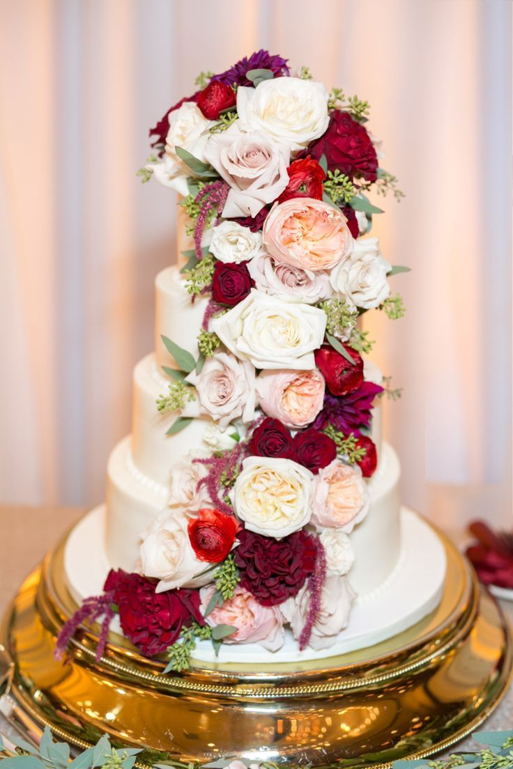 Four tier wedding cake with cascading florals: Floral Design : Flowers By Lesley - http://www.stylemepretty.com/portfolio/flowers-by-lesley Bridesmaids dresses : Amsale - http://amsalebridal.com Wedding Dress: Calvet Couture - http://www.stylemepretty.com/portfolio/calvet-couture   Read More on SMP: http://www.stylemepretty.com/2017/02/13/elegant-romantic-chinese-new-year-affair/