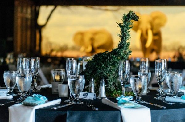 Dinosaur topiary centerpieces at Devon and Faith's wedding at the Los Angeles Natural History Museum. Photos by: Jessica Schilling Photography