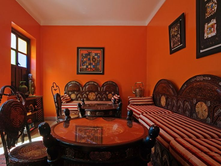 Inspiration Living Room Divine Vintage Style Orange Living Room Ideas  Carving Wooden Chairs Set Also Rounded Coffee Table As Well As Orange Wall  Painted ...
