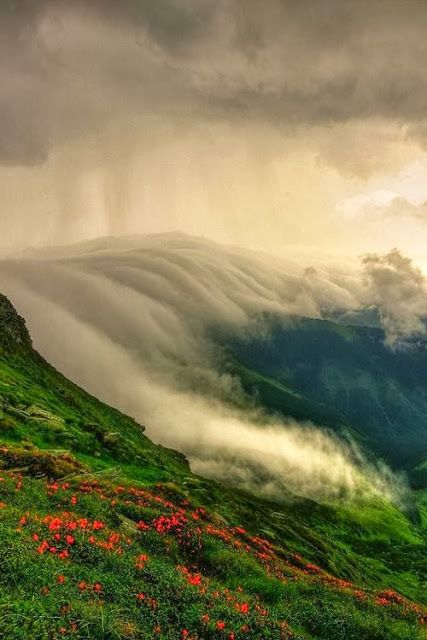 Clouds rolling over the Muntii Rodnei in Romania - The Rodna Mountains are part of the Eastern Carpathians in Northern Romania.- Photo by Lazar Ovidiu
