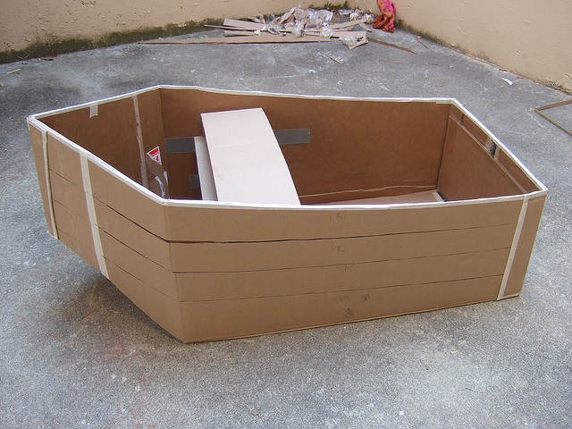 My Rumpus: BOAT  Materials: large cardboard box, cardboard scraps of all sizes, small boxes, 2 poles, small stick, yellow posterboard paper, yellow plastic table covers, rope or twine, L brackets