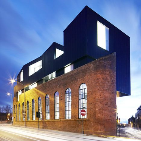 This brick warehouse looks like it has another building on top of it: