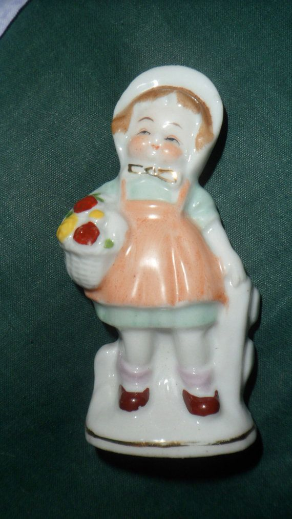 figurine stamped n