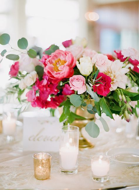gold vase, gold votive candle holders and mixed white votives, bright centrepiece with shades of pink, coral peonies and lots of greenery