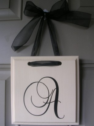 """Monogrammed wall hanger for front door. Would be cute to say """"welcome"""""""