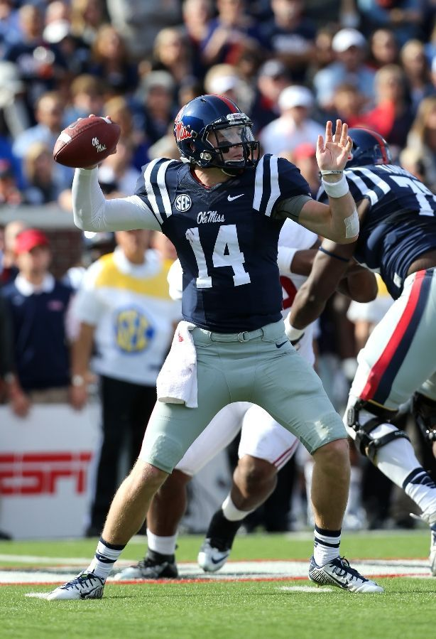 Ole Miss Football - Rebels Photos - ESPN OXFORD, MS - OCTOBER 4: Bo Wallace #14 of the Ole Miss Rebels throws against the Alabama Crimson Tide on October 4, 2014 at Vaught-Hemingway Stadium in Oxford, Mississippi. (Photo by Joe Murphy/Getty Images)