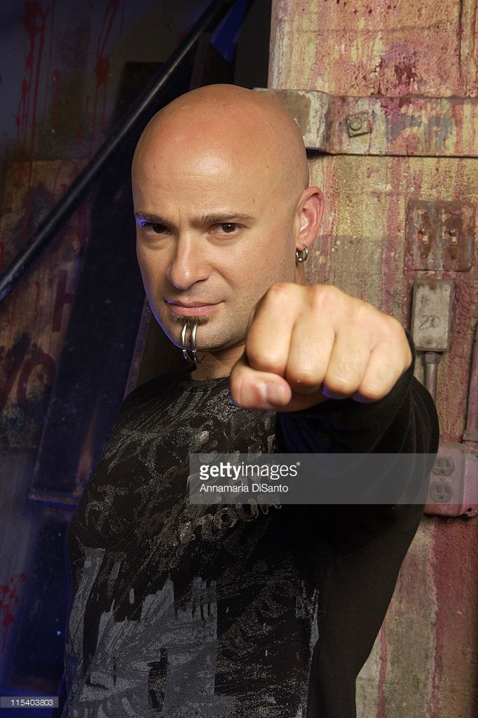 Dave Draiman of Disturbed performing at Live 105. Description from gettyimages.co.uk. I searched for this on bing.com/images