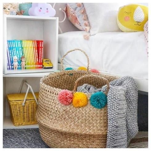 Olli Ella's Pompom Seagrass Baskets are functional (ideal for storing toys, linens, books, and more) and irresistibly cute. Fair trade and handmade with love! 4