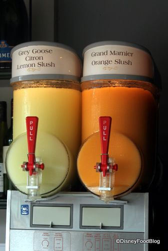 Grand Marnier Orange Slush and Grey Goose Citron/Lemon Slush sit side by side in Epcot's France pavilion at a little outdoor champagne kiosk across from Les Chefs de France.