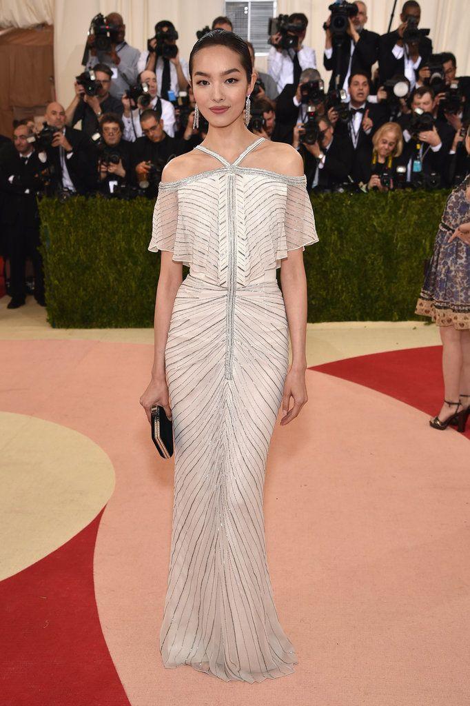 Fei Fei Sun in a shining off-the-shoulder dress.
