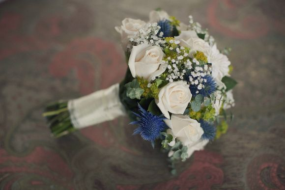 Thistle, baby's breath and white rose bouquet