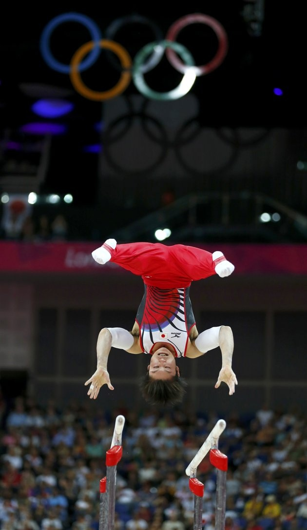 Kohei Uchimura of Japan competes in the parallel bars during the men's individual all-around gymnastics final in London