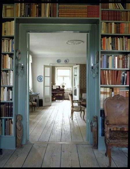pretty blue bookshelves and blue trim