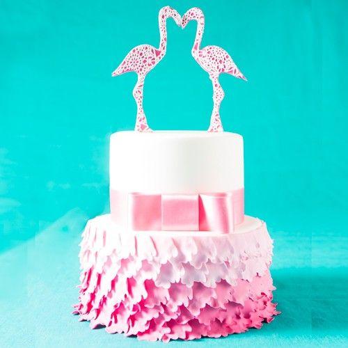 Een mooie taart met een prachtige flamingo topper!