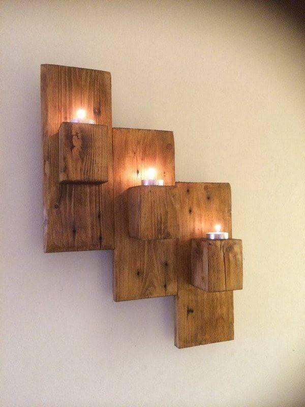 Portavelas con trozos de madera