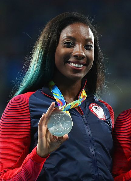 Silver medalist Nia Ali of the United States poses on the podium during the…