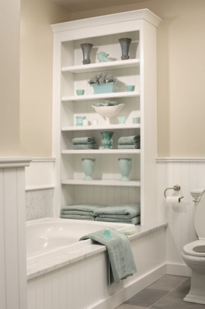 Not only do shelves house towels and other miscellany, but they also give a blank wall a needed focal point.