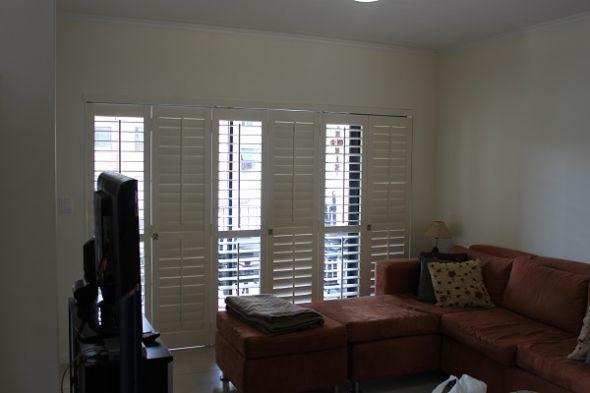 Adjustable folding shutter doors