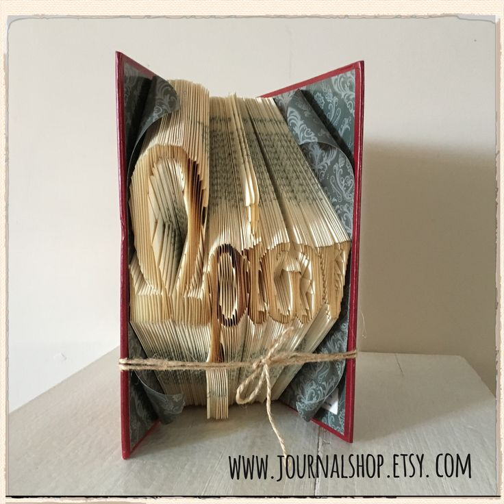 Bookfolding in Greek. It says Ωρίων (means Orion)- what an amazing name for one's child!