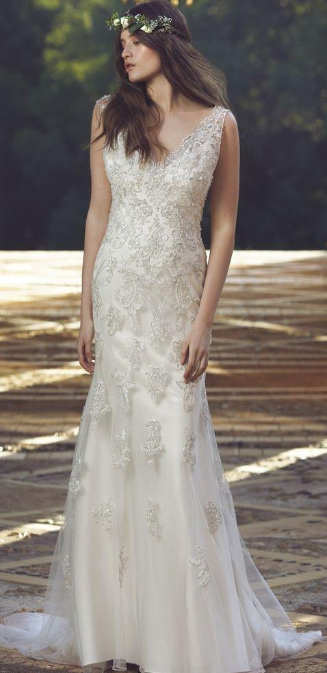 Bohemian chic beaded tulle wedding dress; Featured Dress: Mia Solano