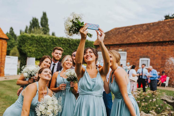 Got to be on hand to snap all the selfies - great group shot! Photo by Benjamin Stuart Photography #weddingphotography #groupshot #groupselfie #bridalparty #weddingparty #drinksreception