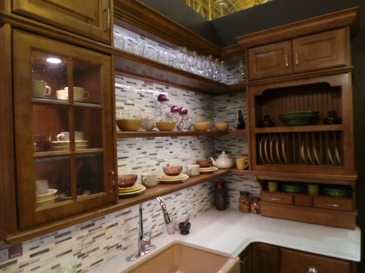 A nice kitchen with open shelving in Wellborn Cabinet's booth