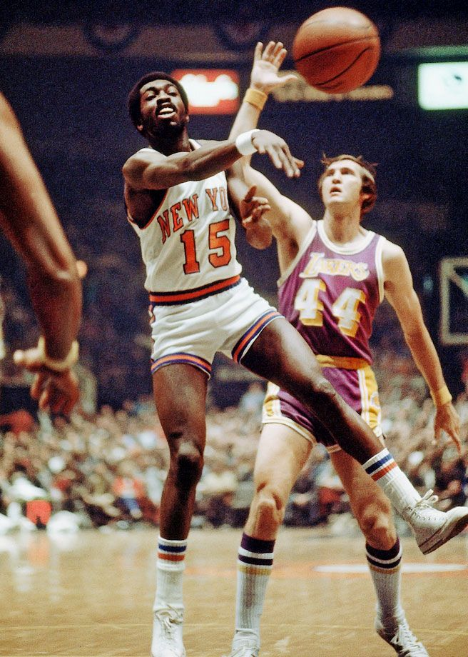 "Knicks guard Earl ""The Pearl"" Monroe dishes out a pass in"