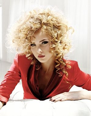 A long blonde curly hairstyle by Richard Ward