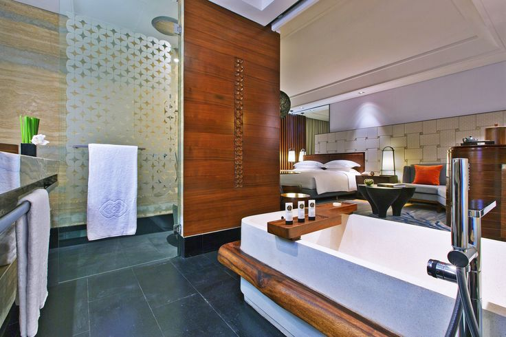 Spacious bathroom at our Luxury Room, Luxury Room Plunge Pool and Luxury Room Pool Access; separate bath-tub and rain shower with distinctive French bathroom amenities.
