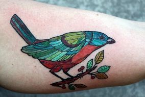 Stainglass inspired bird tattoo